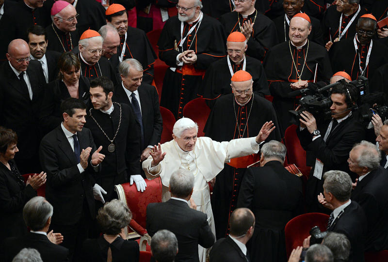 Pope Benedict XVI salutes attendees at the end of a concert at La Scala theater in Milan, Italy, Friday, June 1, 2012. Pope Benedict XVI greeted the faithful in the square outside Milan's cathedral after his arrival Friday afternoon for the seventh World Encounter of Families, a welcome pastoral respite from an embarrassing and damaging leaks scandal at the Vatican that has engulfed the pontiff's personal butler. Then, a concert at the nearby La Scala theater will be followed by a private prayer inside the cathedral with a special focus on the victims of the twin temblors that rocked the Emilia-Romagna region last month. (AP Photo/Daniel Dal Zennaro, Pool)