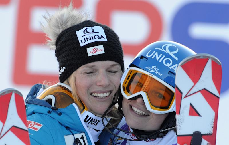 Austria's Marlies Schild, left, winner of an alpine ski, women's World Cup slalom, hugs her sister Bernadette, who finished in third place, in Courchevel, France, Tuesday, Dec. 17, 2013. (AP Photo/Giovanni Auletta)