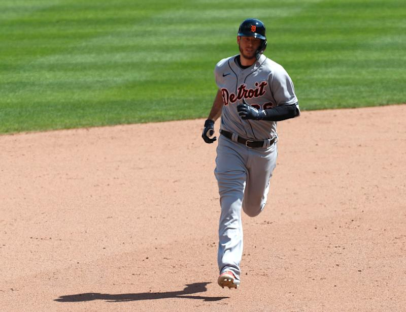 Detroit Tigers first baseman C.J. Cron rounds the bases after hitting a go-ahead two-run home run against the Cincinnati Reds during the ninth inning at Great American Ball Park, July 26, 2020.
