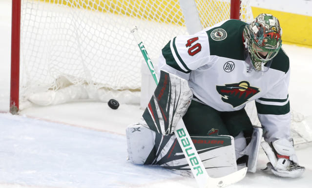 Minnesota Wild goaltender Devan Dubnyk gives up a goal to Dallas Stars center Andrew Cogliano, not seen, during the second period of an NHL hockey game in Dallas, Friday, Feb. 1, 2019. (AP Photo/LM Otero)