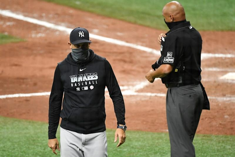 Aaron Boone walks off field after ejection against Rays
