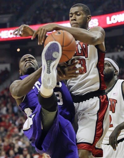 TCU's J.R. Cadot, left, fights for a rebound against UNLV's Mike Moser in the first half of an NCAA college basketball game, Wednesday, Jan. 18, 2012, in Las Vegas. (AP Photo/Julie Jacobson)
