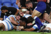 New Zealand's Sevu Reece, center, scores a try against Argentina during their Rugby Championship match on Sunday, Sept. 12, 2021, on the Gold Coast, Australia. (AP Photo/Tertius Pickard)
