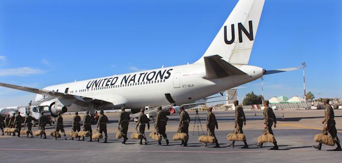 Mauritanian soldiers board a United Nations flight to Central African Republic as a peacekeeping force in Nouakchott, Mauritania, on Feb 21, 2016. (Photo: Ahmed Mohamed/AP)