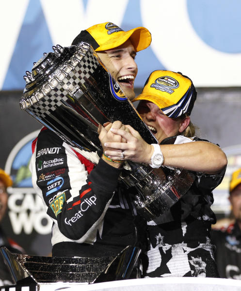 James Buescher, left, and a team member celebrate after winning the NASCAR Nationwide Truck Series championship on Friday, Nov. 16 2012, at Homestead-Miami Speedway in Homestead, Fla. (AP Photo/Terry Renna)