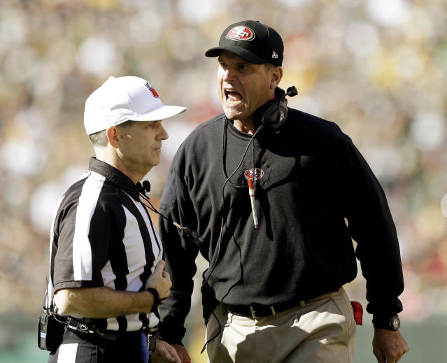 San Francisco 49ers head coach Jim Harbaugh argues a call with referee David White during the first half of an NFL football game against the Green Bay Packers Sunday, Sept. 9, 2012, in Green Bay, Wis. (AP Photo/Jeffrey Phelps)