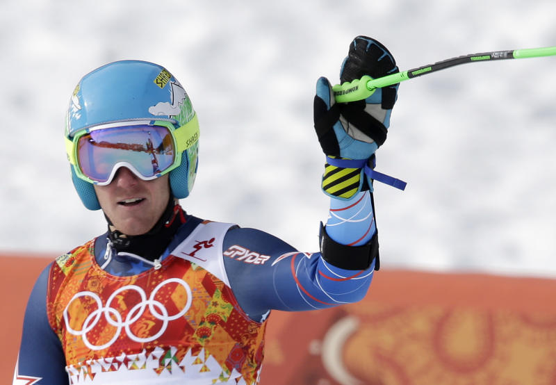 United States' Ted Ligety waves from the finish area after completing the first run of the men's giant slalom at the Sochi 2014 Winter Olympics, Wednesday, Feb. 19, 2014, in Krasnaya Polyana, Russia. (AP Photo/Gero Breloer)
