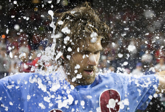 Philadelphia Phillies' Bryce Harper is doused following his grand slam ended the team's baseball game against the Chicago Cubs, Thursday, Aug. 15, 2019, in Philadelphia. The Phillies won 7-5. (AP Photo/Chris Szagola)