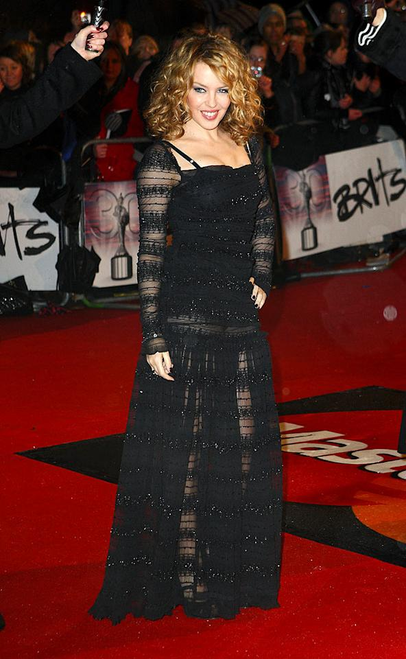 """Right behind Lily on the red carpet was diminutive diva Kylie Minogue, whose sheer Dolce & Gabbana dud of a dress truly disappointed. Mike Marsland/<a href=""""http://www.wireimage.com"""" target=""""new"""">WireImage.com</a> - February 16, 2010"""