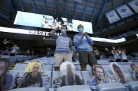 Fans return to the Dean E. Smith Center for an NCAA college basketball game between North Carolina and Florida State in Chapel Hill, N.C., Saturday, Feb. 27, 2021. A limited number of fans were permitted as the state eases restrictions that were in place due to the coronavirus. (AP Photo/Gerry Broome)