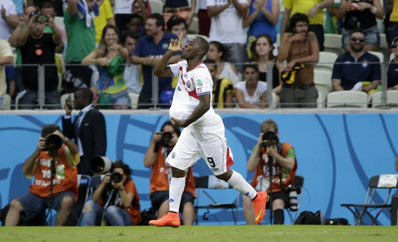 Costa Rica's Joel Campbell celebrates scoring his side's first goal during the group D World Cup soccer match between Uruguay and Costa Rica at the Arena Castelao in Fortaleza, Brazil, Saturday, June 14, 2014