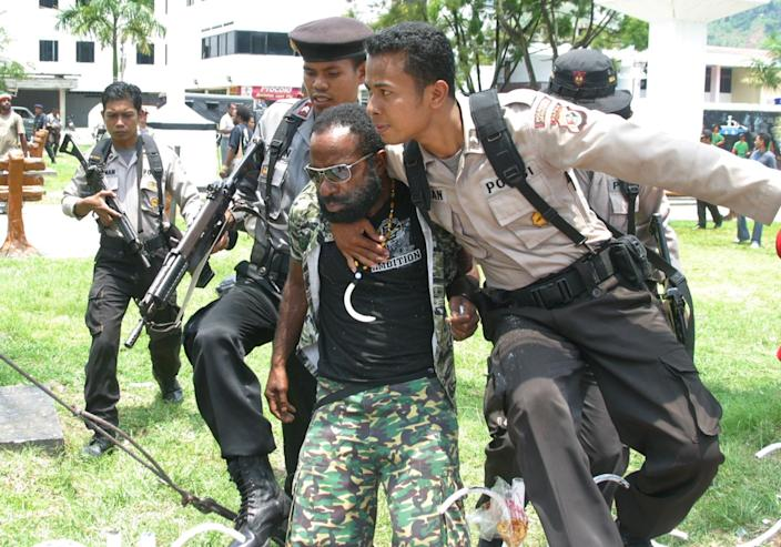 "Indonesian police arrest Papuan pro-independence leader Buchtar Tabuni at a rally in the provincial capital of Jayapura in 2008. <span class=""copyright"">(Jefri Pattirajawne / Associated Press)</span>"