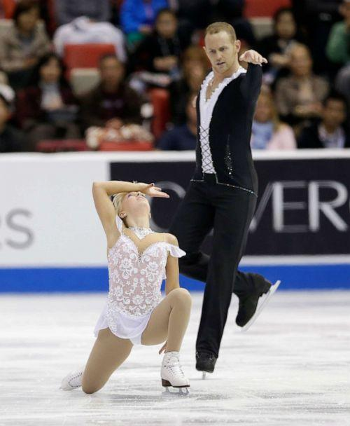 PHOTO: Caydee Denney and John Coughlin perform during the pairs free skating routine at the Skate America figure skating competition in Detroit, Sunday, Oct. 20, 2013. (Carlos Osorio/AP Photo)