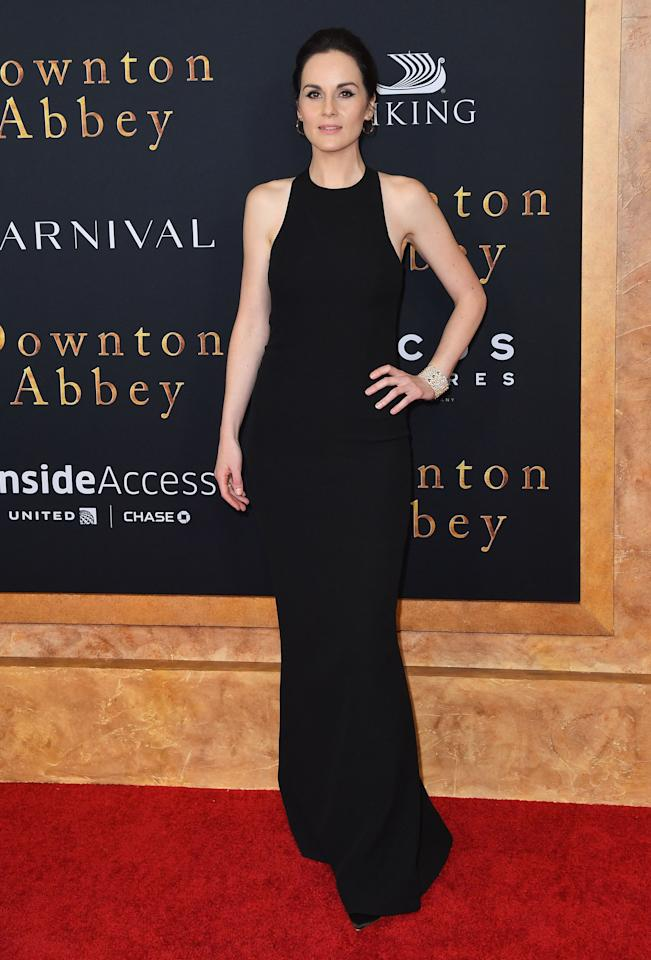 Michelle Dockery wore a sleek black Armani dress at the Downton Abbey New York premiere. [Photo: Getty Images]