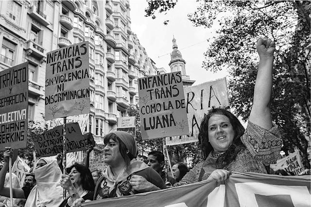 <p>Florencia and Alejandro attend the Marcha de la Memoria (March of Remembrance) to mark the beginning of state-sponsored terror that occurred under the military dictatorship from 1976 to 1983. (Copyright © 2018 by Kike Arnal. These images originally appeared in Revealing Selves: Transgender Portraits from Argentina, published by The New Press. Reprinted here with permission.) </p>