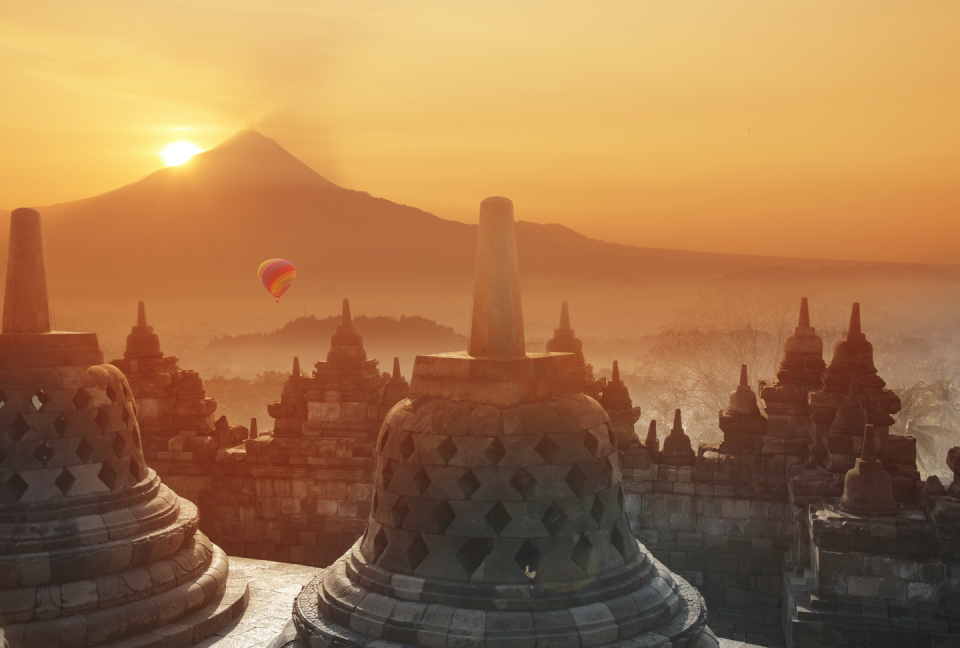 <p>When seeking the best views in the world, Borobudur in Central Java, a 9th century UNESCO World Heritage Site, is must for bucket-list worthy sunrises. Enveloped by dense, emerald green jungles, the views from Borobudur–the largest Buddhist temple in the world–give way to vibrant skies that overlook the majestic Mount Merapi. </p><p>The temple itself is supremely otherworldly, a dramatically peculiar pyramid with 9 levels sculpted from grey volcanic stone, where Buddhist relics and illustrations paint an intimate portrait of this spiritual universe. The most mystical part of the sunrise experience is absorbing the view while listening to the monks complete their morning chants–this view is multi-sensory, transcendent, and deeply moving. <br></p>