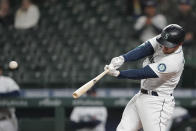 Seattle Mariners' Kyle Seager hits a sacrifice fly to score Sam Haggerty in the eighth inning of a baseball game against the Baltimore Orioles, Tuesday, May 4, 2021, in Seattle. (AP Photo/Ted S. Warren)