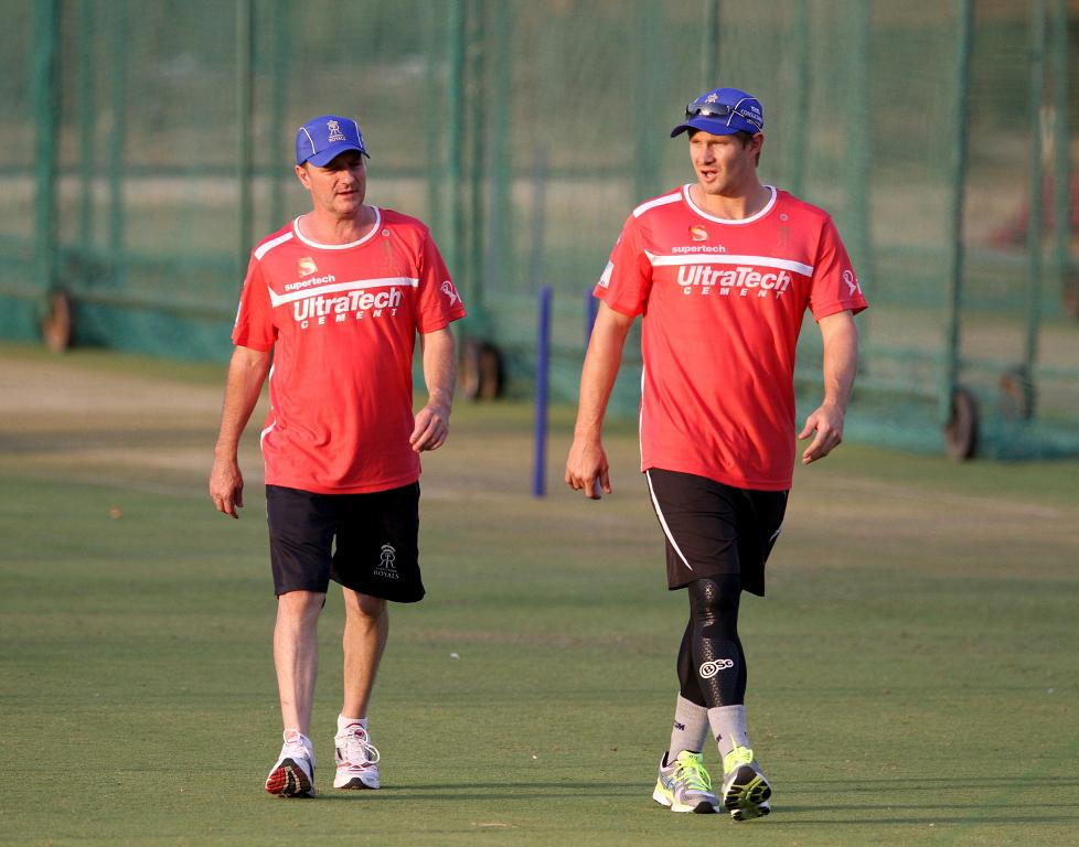 Rajasthan Royals' Shane Watson (R) with team physio John Gloster during a practice session at Sawai Mansingh Stadium in Jaipur on Sunday
