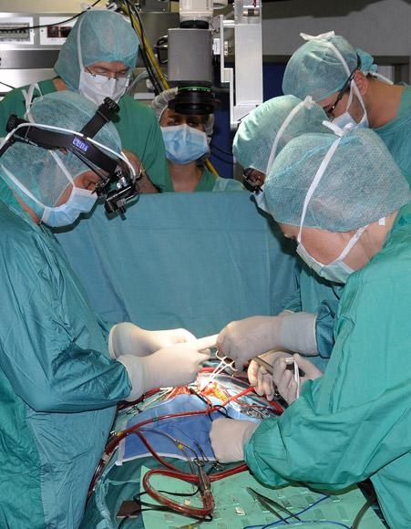 Italian heart surgeon Antonio Amodeo and his team implant a tiny titanium pump, the world's smallest artificial heart, in a baby, at the Bambino Gesu' Hospital in Rome, in this undated handout picture made available to Reuters May 24, 2012. Doctors from Rome's Bambino Gesu' Hospital saved the life of the 16-month-old baby in March with the artificial heart, which weighs only 11 grams, before the infant received an organ donation.  REUTERS/Press Office Bambino Gesu' Hospital