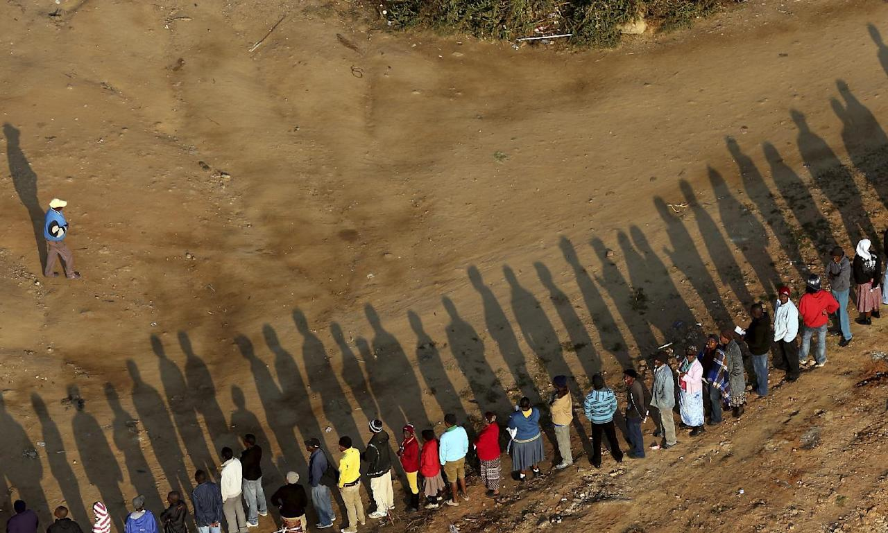 South Africans queue to vote at a polling station at a informal settlement in Zandspruit, west of Johannesburg, South Africa, Wednesday, May 7, 2014. South Africa goes to the polls on Wednesday, May 7, 2014. South Africans voted Wednesday in elections that are expected to see the ruling African National Congress return to power despite a vigorous challenge from opposition parties seeking to capitalize on discontent with corruption and economic inequality. (AP Photo/Themba Hadebe)
