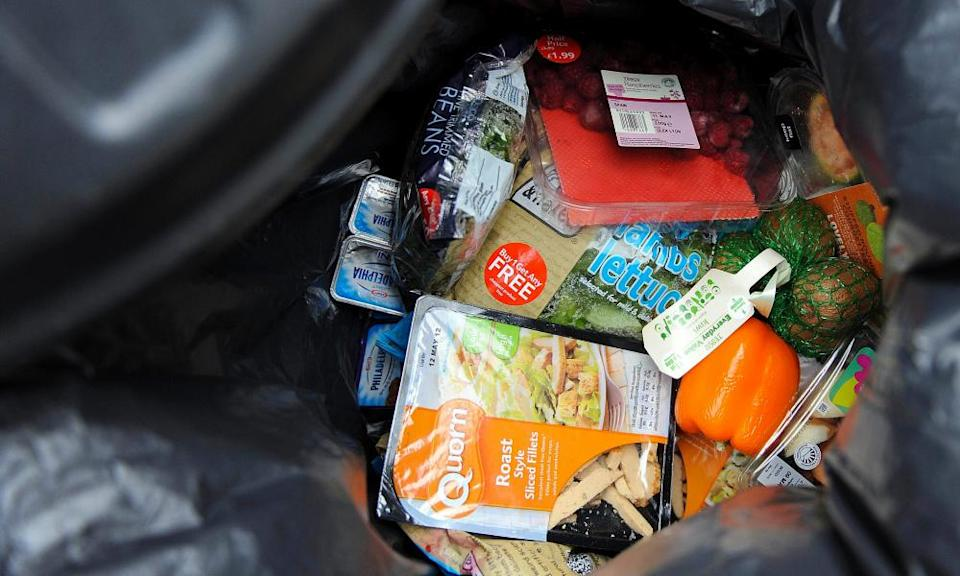 'Out-of-date', unopened food in a household rubbish bin.