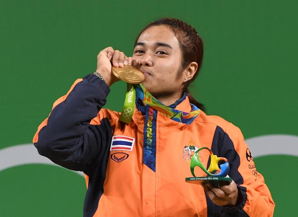 Sopita Tanasan, 21, was the first Thai athlete to secure a medal in Rio, winning gold in the women's weightlifting 48kg competition (AFP Photo/Goh Chai Hin)