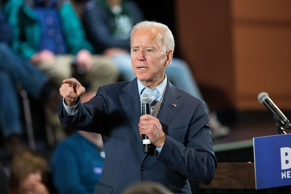 Former Vice President Joe Biden takes questions at a Dec. 30 campaign town hall in Derry, New Hampshire. Biden favors a public option for health coverage. (Photo: Scott Eisen via Getty Images)