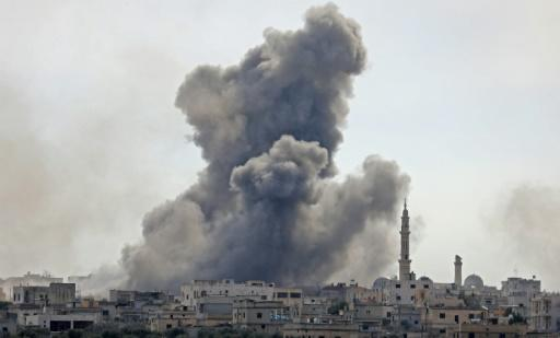 Smoke billows from the Syrian village of al-Nayrab in the northwestern Idlib province during bombardment by Syrian government forces and its allies