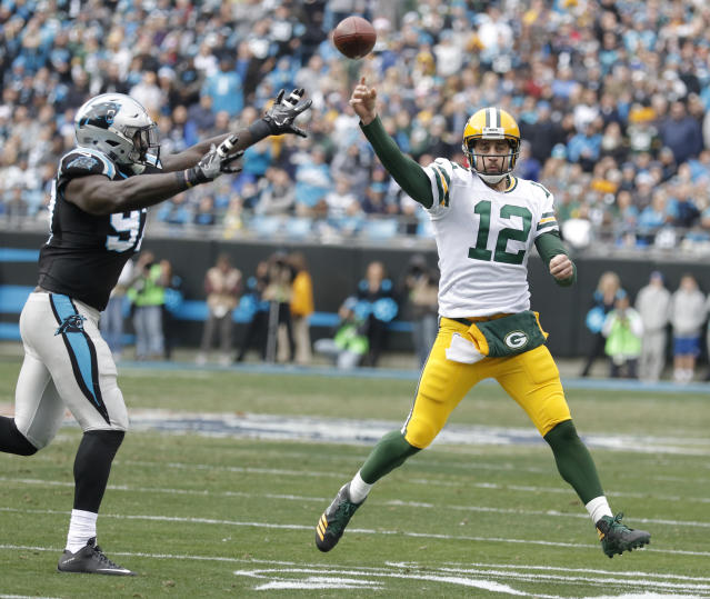 """<a class=""""link rapid-noclick-resp"""" href=""""/nfl/players/7200/"""" data-ylk=""""slk:Aaron Rodgers"""">Aaron Rodgers</a> welcomes back old offensive coordinator Joe Philbin to Green Bay. (AP Photo/Bob Leverone)"""