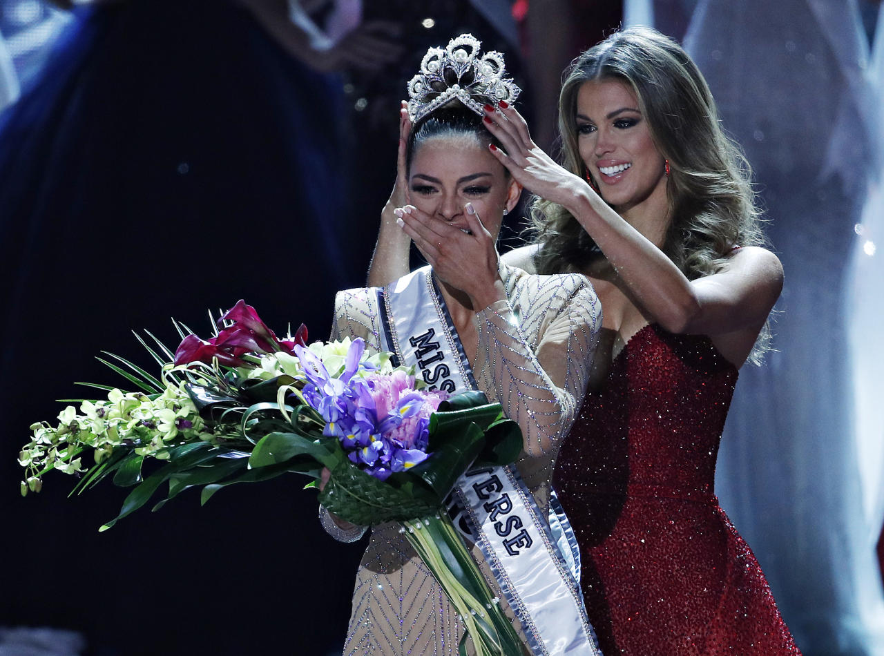 <p>Formers Miss Universe Iris Mittenaere, right, crowns new Miss Universe Demi-Leigh Nel-Peters at the Miss Universe pageant Sunday, Nov. 26, 2017, in Las Vegas. (AP Photo/John Locher) </p>