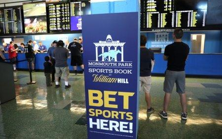 Gamblers place bets on sports at Monmouth Park Sports Book by William Hill, shortly after the opening of the first day of legal betting on sports in Oceanport, New Jersey, U.S., June 14, 2018. REUTERS/Mike Segar