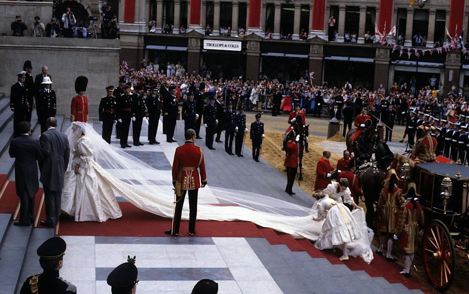 Princess Diana's wedding party attempts to straighten her lengthy train.