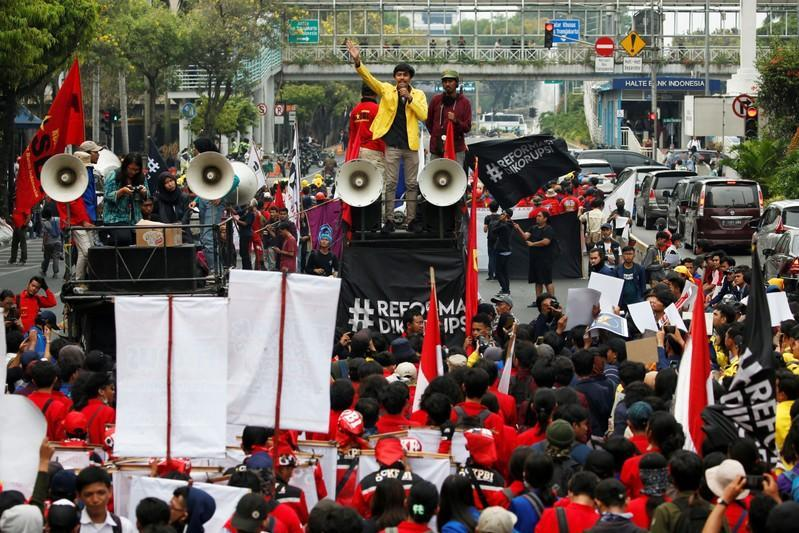 Manik Marganamahendra, a student leader at the University of Indonesia, gestures as he delivers a speech during a protest over human rights, corruption and social and environmental issues in Jakarta, Indonesia