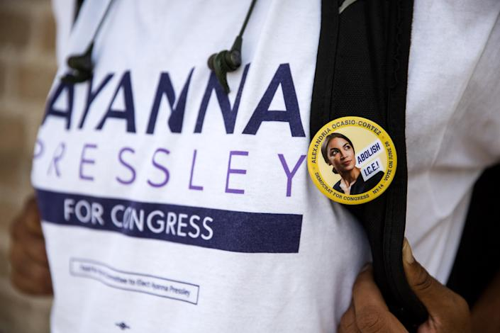 """<span class=""""s1"""">A Pressley staffer, who assisted Ocasio-Cortez earlier this summer, sports both a Pressley T-shirt and an Ocasio-Cortez pin. (Photo: Kayana Szymczak for Yahoo News)</span>"""