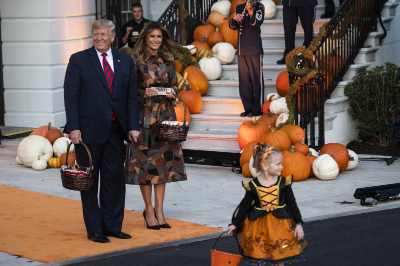 WASHINGTON, DC - OCTOBER 28 : President Donald J. Trump and First Lady Melania Trump hand out commemorative candy to trick-or-treaters in front of the South Portico of the White House on Monday, Oct 28, 2019 in Washington, DC. (Photo by Jabin Botsford/The Washington Post via Getty Images)
