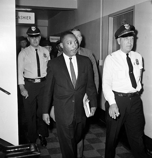<p>Dr. Martin Luther King Jr. leaves court after a four-month sentence in Atlanta, Ga., Oct. 25, 1960, for taking part in a lunch counter sit-in at Rich's department store. (AP Photo) </p>