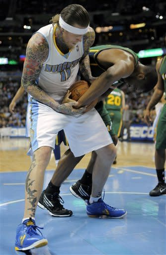 Denver Nuggets center Chris Andersen (11) and Utah Jazz forward Derrick Favors (15) fight for possession during the second quarter of an NBA basketball game, Sunday, Jan. 15, 2012, in Denver. (AP Photo/Jack Dempsey)