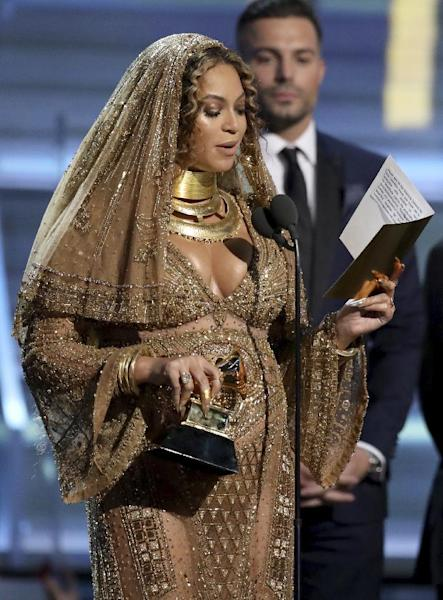 "Beyonce accepts the award for best urban contemporary album for ""Lemonade"" at the 59th annual Grammy Awards on Sunday, Feb. 12, 2017, in Los Angeles. (Photo by Matt Sayles/Invision/AP)"