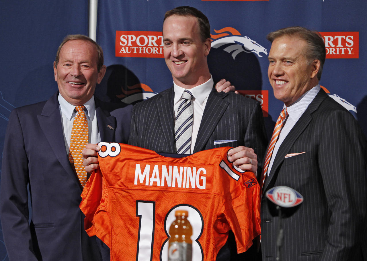 New Denver Broncos quarterback Peyton Manning, center, is flanked by Broncos owner Pat Bowlen, left, and vice president John Elway during a news conference at the NFL Denver Broncos headquarters in Englewood, Colo., on Tuesday, March 20, 2012. (AP Photo/Ed Andrieski)