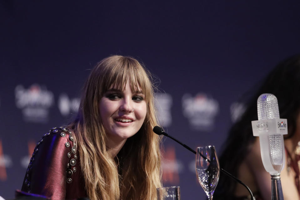Victoria De Angelis responds to questions at the press conference after her band Maneskin from Italy won the Grand Final of the Eurovision Song Contest at Ahoy arena in Rotterdam, Netherlands, Saturday, May 22, 2021. (AP Photo/Peter Dejong)