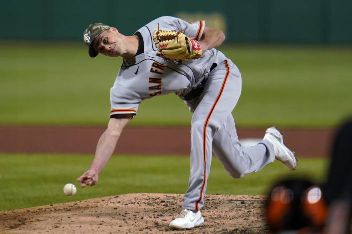San Francisco Giants relief pitcher Tyler Rogers delivers during the 10th inning of the team's baseball game against the Pittsburgh Pirates in Pittsburgh, Friday, May 14, 2021.(AP Photo/Gene J. Puskar)
