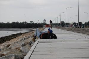 Man sleeping on the boardwalk