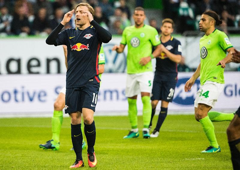 Emil Forsberg (left) groans after failing to convert a penalty for Leipzig at Wolfsburg on October 16, 2016 (AFP Photo/Odd Andersen)