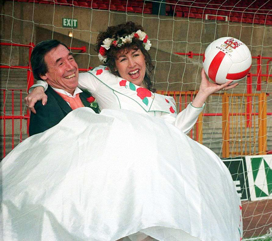 <p>Former England goalie Gordon Banks with his daughter Wendy in the goalmouth at Stoke City Football club after her marriage at the ground today to Shaun Beech. </p>