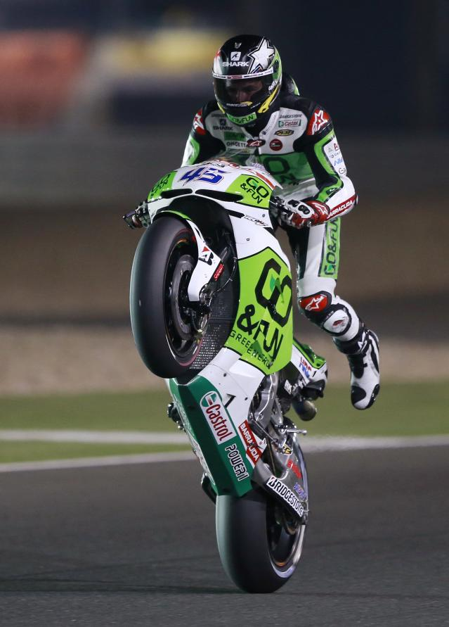 Honda Gresini MotoGP rider Scott Redding of Britain rides his bike during a free practice session at the MotoGP World Championship at the Losail International circuit in Doha March 21, 2014. REUTERS/Mohammed Dabbous (QATAR - Tags: SPORT MOTORSPORT)