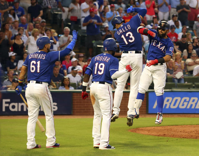 Texas Rangers Robinson Chirinos (61), Jurickson Profar (19) and Joey Gallo (13) celebrate the home run by Rougned Odor (12) against the New York Yankees in the fourth inning of a baseball game Monday, May 21, 2018, in Arlington, Texas. (AP Photo/Richard W. Rodriguez)