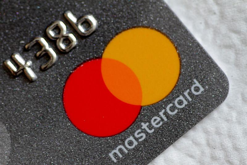 Illustration photo of a Mastercard logo on a credit card