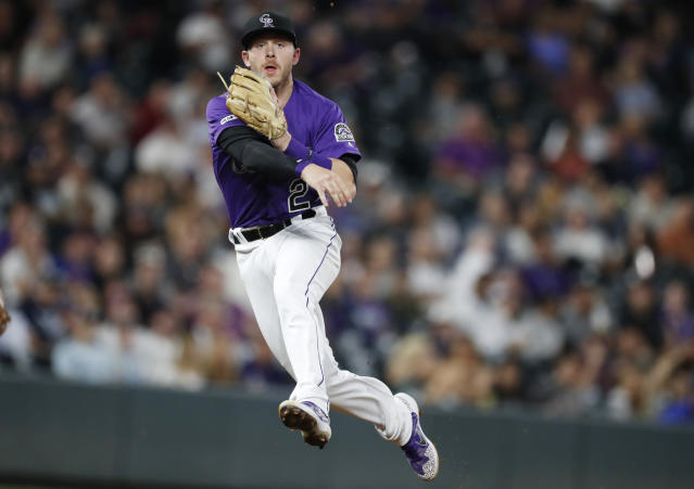 FILE - In this Sept. 17, 2019, file photo, Colorado Rockies shortstop Trevor Story throws to first base to put out New York Mets' Marcus Stroman during the sixth inning of a baseball game in Denver. Story asked for $11.5 million and the Rockies offered him $10.75 million when players and teams exchanged proposed salaries in salary arbitration Friday, Jan. 10. Colorado catcher Tony Wolters also could be headed toward a hearing next month after requesting a raise from $960,000 to $2,475,000. The Rockies offered $1.9 million. (AP Photo/David Zalubowski, File)
