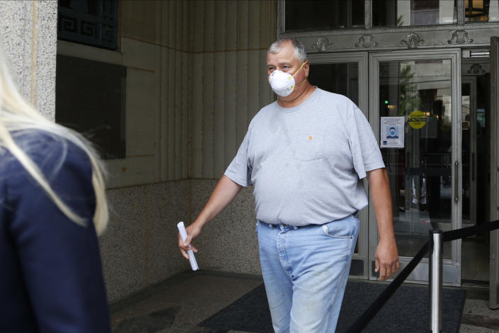 FILE - In this Tuesday, July 21, 2020, file photo, Ohio House Speaker Larry Householder leaves the federal courthouse after an initial hearing following charges against him and four others alleging a $60 million bribery scheme, in Columbus, Ohio. (AP Photo/Jay LaPrete, File)
