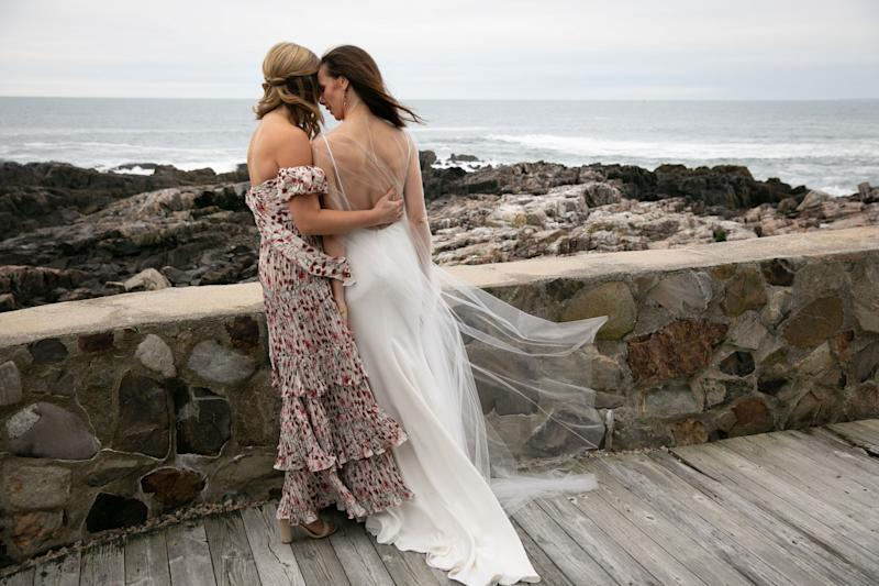 A quiet moment with Jenna before the ceremony. Jenna's off-the-shoulder floral dress is by Johanna Ortiz.
